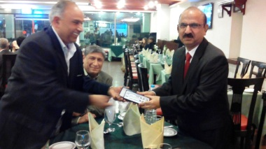Dr. Saleem presents a gift to the AIOU Vice Chancellor