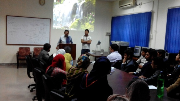 Moiz Ahmed, Academic Liaison to PDEEP and Atif Solangi Contract Manager addressing the graduating Computer Science students from AIOU's Regional Campus in Lahore.